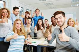 bigstock-many-happy-students-with-teach-50192378-768x510